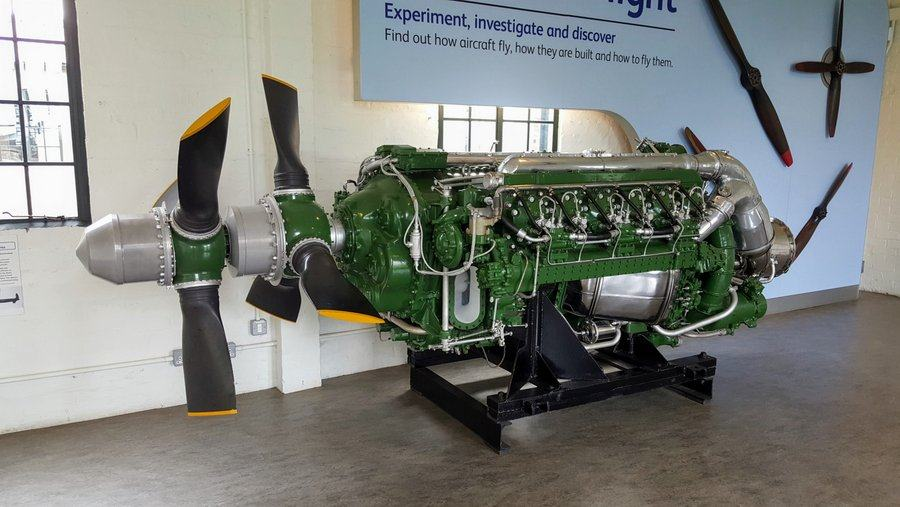 Green painted aero engine with a double propeller