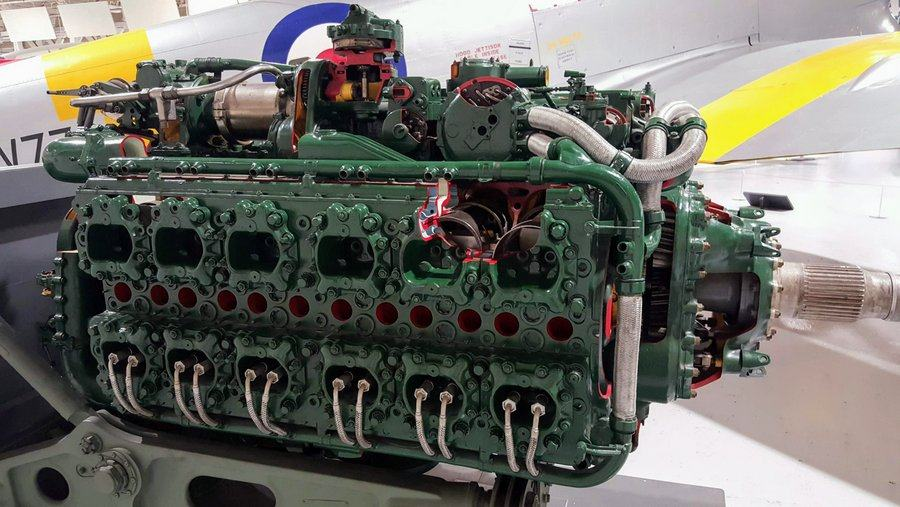 A green painted aero engine displayed on a stand