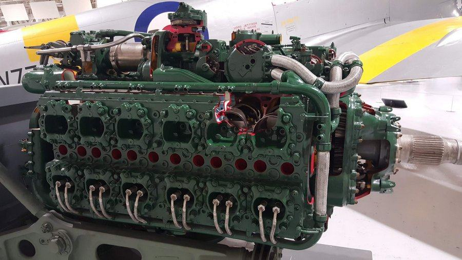 Green painted aero engine with sections cutaway