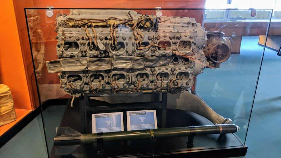 A damaged aero engine in a display case