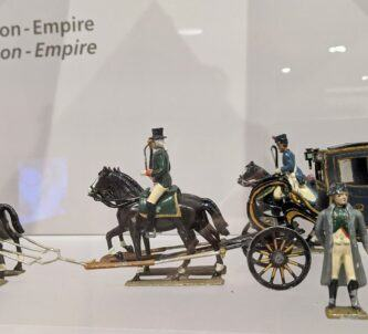 Napoleon figurine with coach and horses