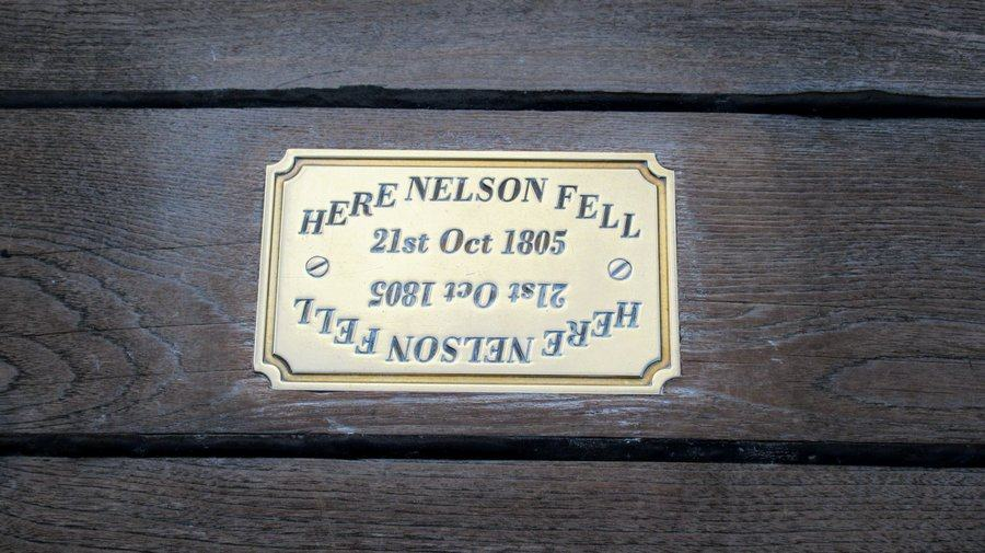 "A small brass plaque on the wooden deck saying ""Here Nelson fell, 21st Oct 1805"""