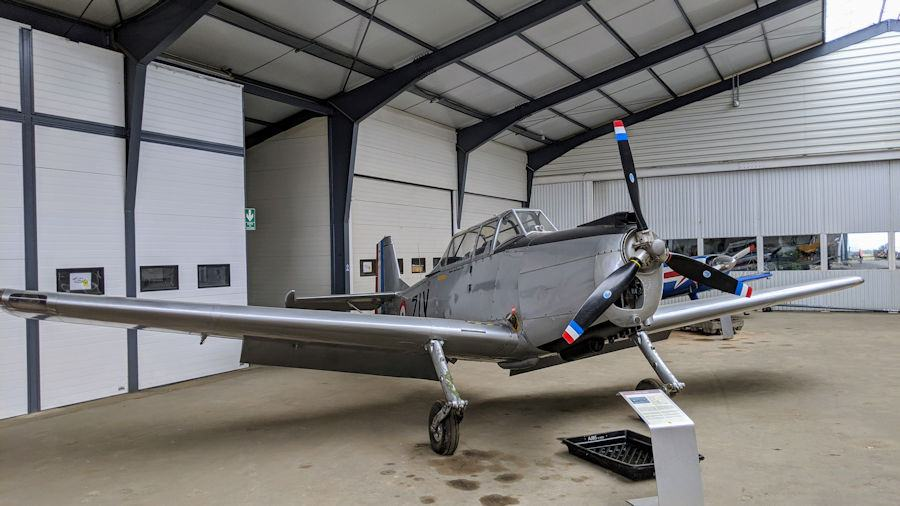 Grey metal, single engined trainer aircraft, on display at the Salis Flying Museum