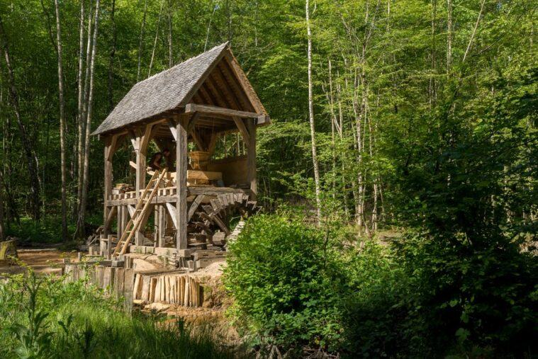 Medieval open sided watermill in the woods