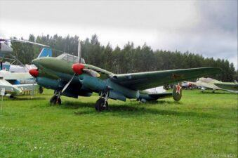A recent photo of a Petlyakov Pe-2 bomber on display with other aircraft in a green field