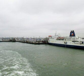 Two P&O Ferries berthed in Calais on a grey day