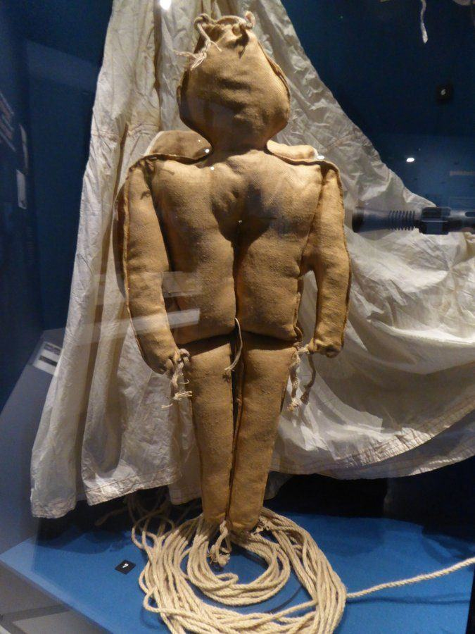 Simple hessian & straw dummy figure with a parachute