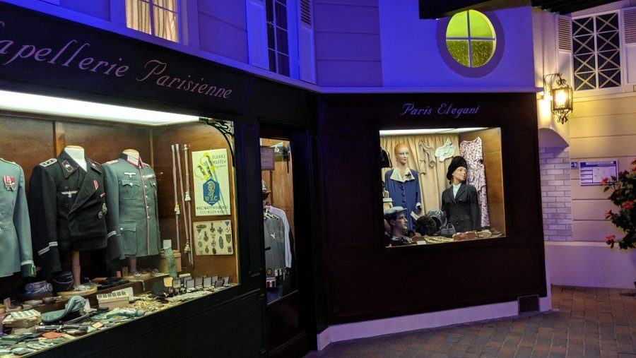 A recreation of Parisien clothes shops in a night time setting