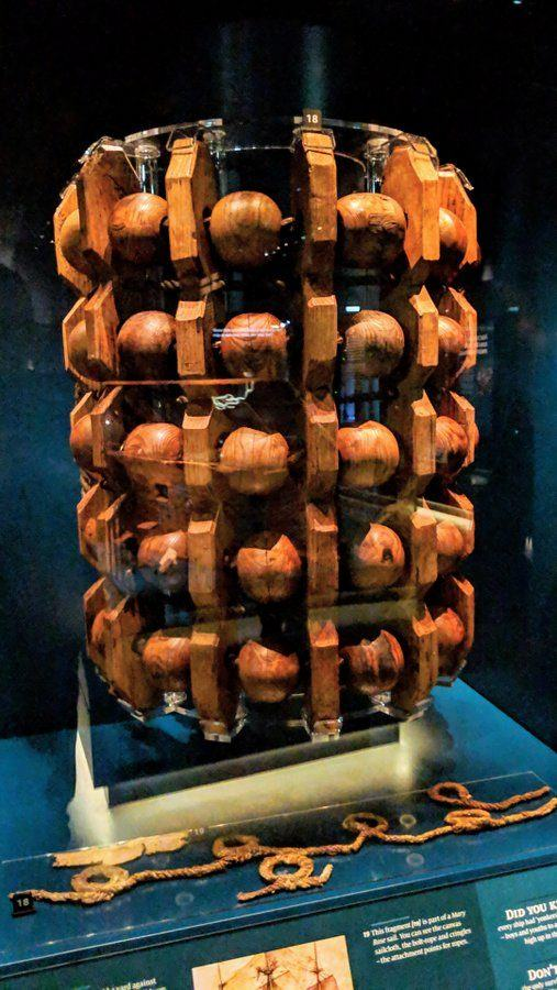 A cradle of wooden balls and separators