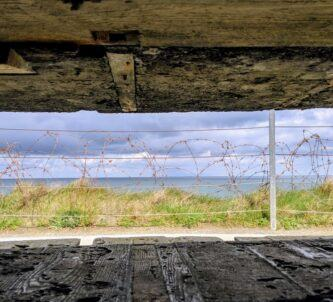 A view of the sea through a slit in the concrete observation bunker