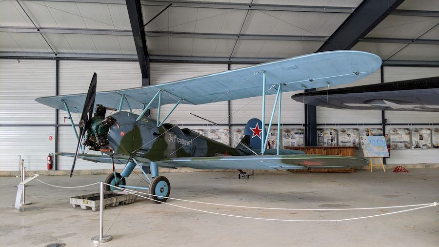Slender biplane with a Russian Red Star on the tail. The Polikarpov PO-2 is displayed at the Salis Flying Museum