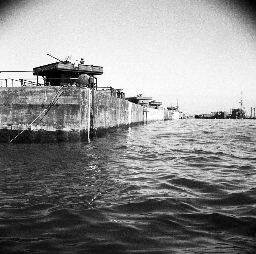 B&W photo of concrete caissons with AA guns on top