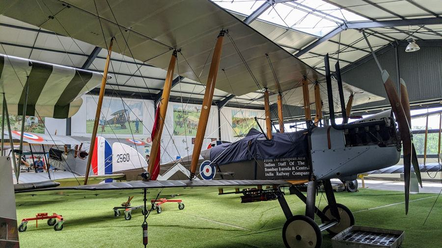 Early WWI green-painted British biplane carrying bombs, on display at the Salis Flying Museum