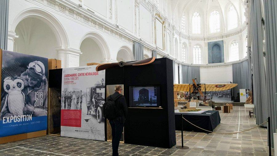 A man looking at a display panel at the start of the RAF in St Omer Exhibition