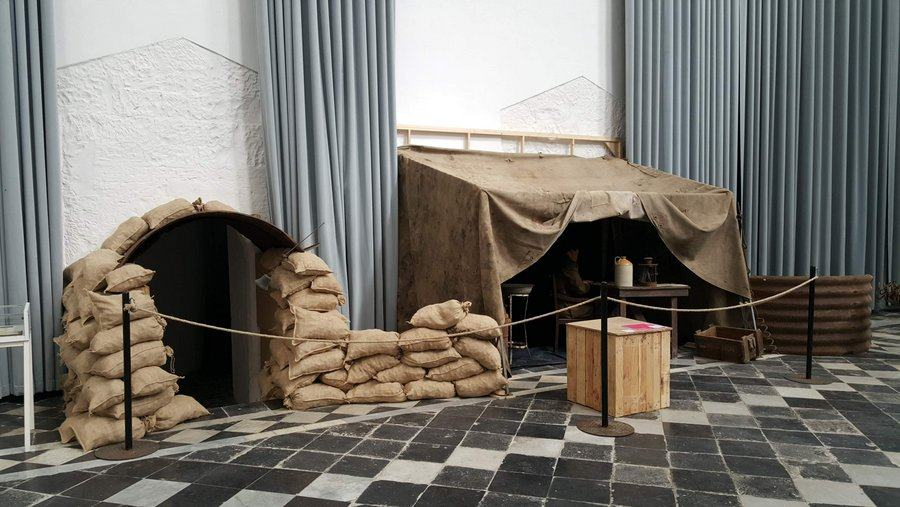 Recreation of a pilots tent on the airfield with sandbags surrounding it