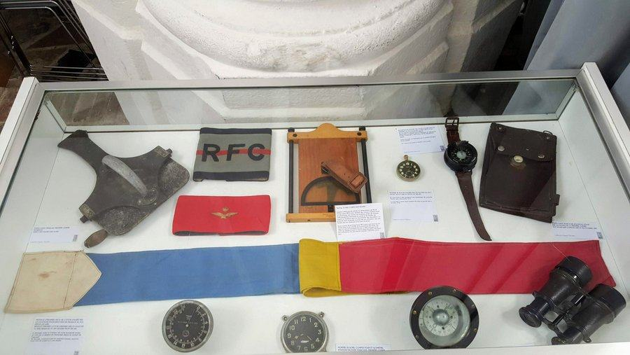 A cabinet of WW1 pilots' accessories such as compasses, watches, and a map holder in the 'RAF in St Omer' 100th anniversary exhibition