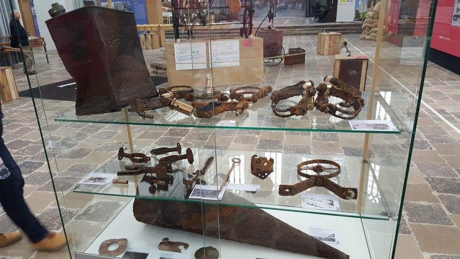 A cabinet of rusty artifacts in the 'RAF in St Omer' 100th anniversary exhibition
