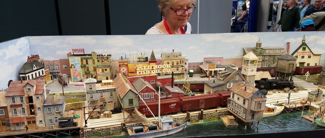 Woman looking at a model railway layout