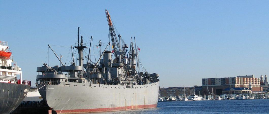 Grey cargo ship on a bright sunny day. The SS John W. Brown WW2 Liberty ship in Baltimore.