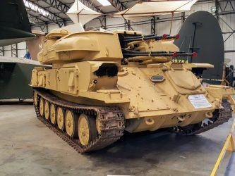 4-barreld light tank in light brown desert camouflage