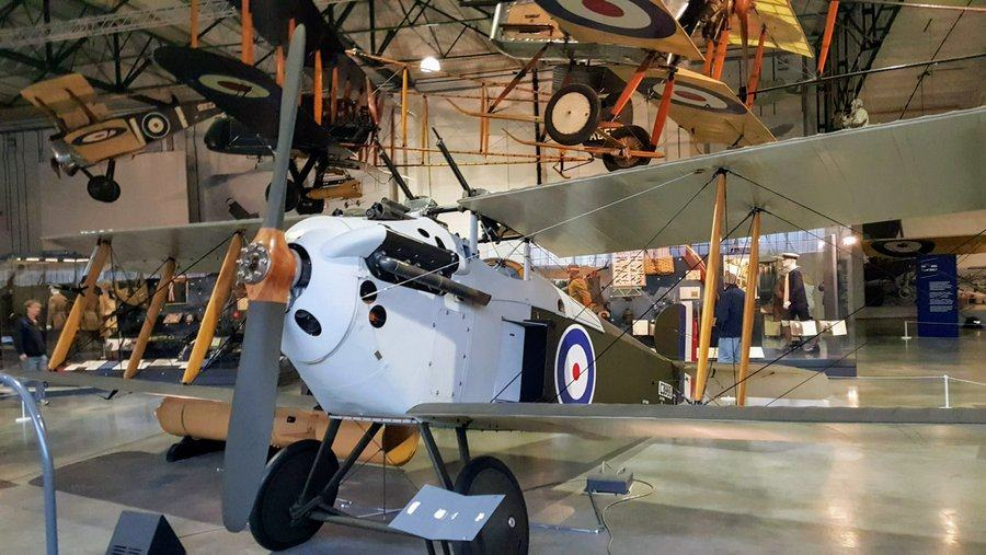 British biplane with a sky blue 7 green fuselage