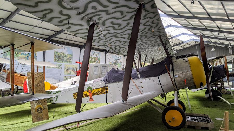 Grey painted, two seater biplane. The Sopwith 1½ Strutter 1B2 is dispayed at the Salis Flying Museum