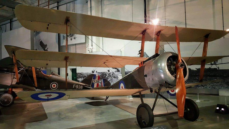 Triplane with a silver nose and dark green fuselage