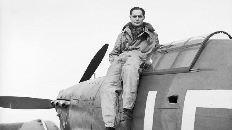 SL Douglas Bader sat on his Hurricane fighter aircraft