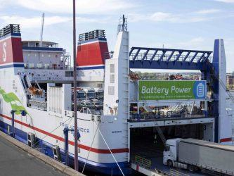 "Stena Jutlandica in port loading vehicles. She has a big green sign on her stern saying ""Battery Power""."