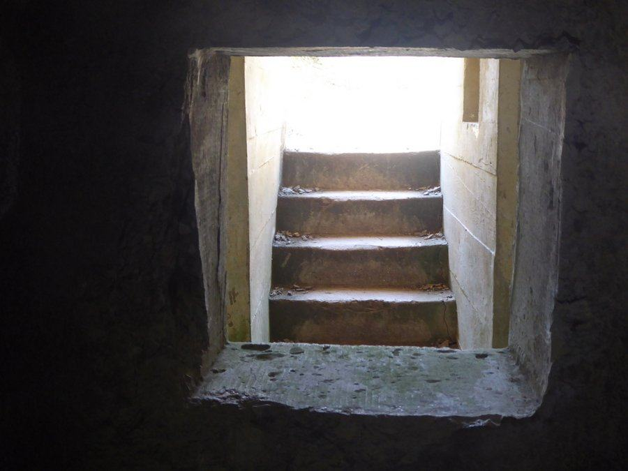 View of the steps out to the daylight from inside a bunker
