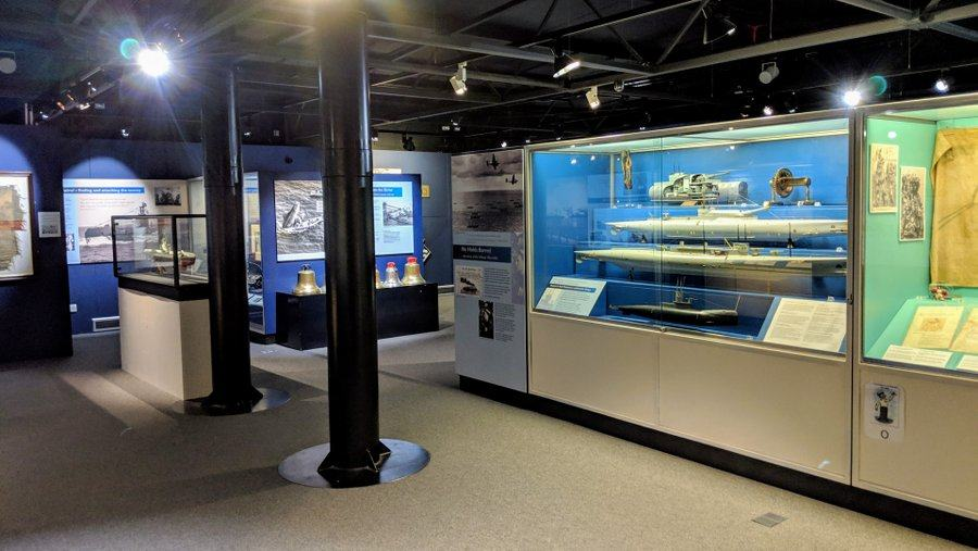 Gallery with model submarines in display case