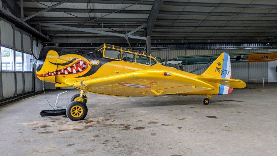 Single engined WW2 era all-metal trainer, painted bright yellow with a shark's teeth mouth. On display at the Salis Flying Museum