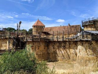 Castle under construction under a blue sky