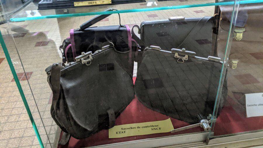 A display of rail conductors' satchels