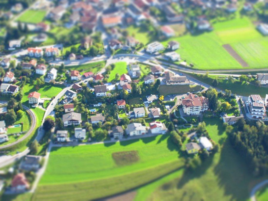 Tilt-shift aerial photo of a village in the Austria Alps