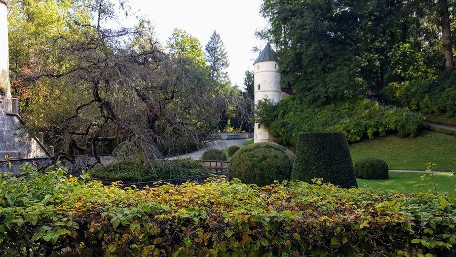 Wider view of tower in the garden at Schloss Ambras