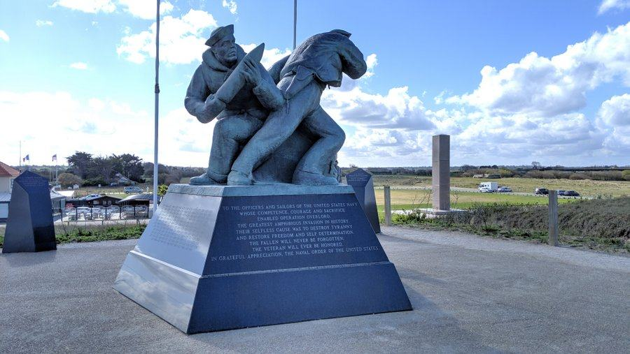 A large sculpture of navy personnel