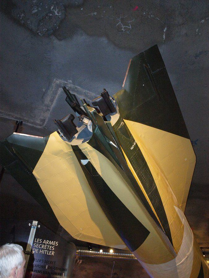 Green & brown camouflaged rocket tail fins