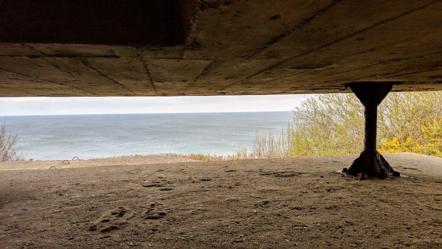 View out to sea through a slit