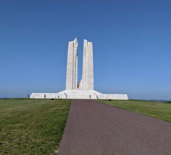 The white stone Canadian National Vimy Memorial memorial set against a blue sky