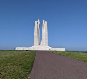 The white stone Canadian National Vimy Memorial memorial set against a blue sky