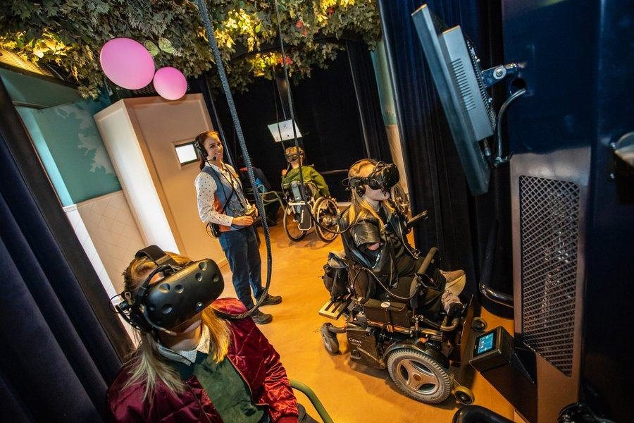 Visitors in wheelchairs experiencing VR