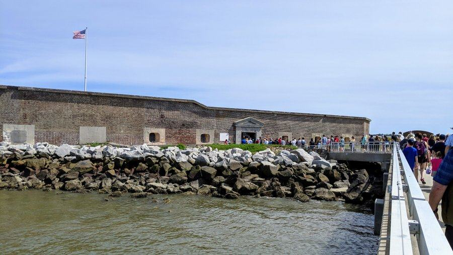 Visitors walk to the entrance of Fort Sumter