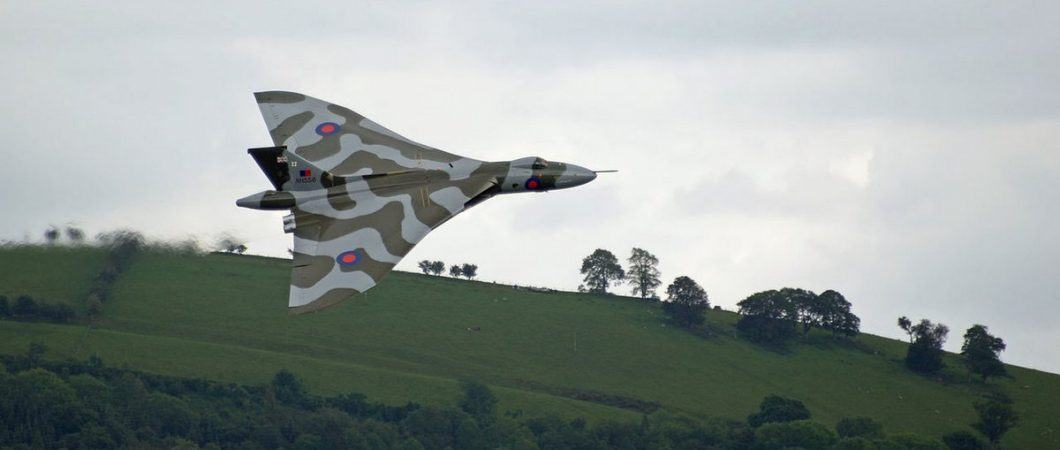 Vulcan flying past hills in Wales