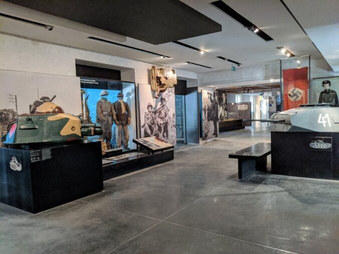 Museum gallery with photo displays and tank turrets