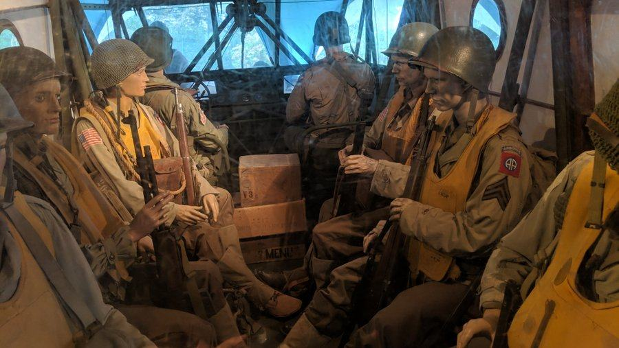 Dummy soldiers with yellow lifejackets sit in the cramped confines of the steel tube & canvas glider