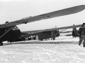 A pair of US Army Waco gliders in a snowy field