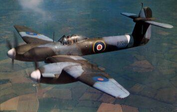 Rare WW2 era colour photo of a Whirlwind in flight with the pilot looking up at the camera