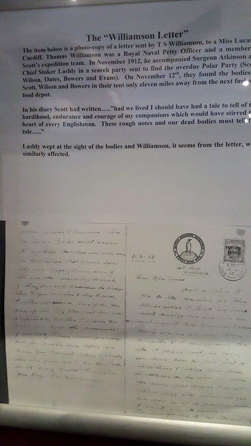 An annotated hand-written letter displayed behind reflective glass