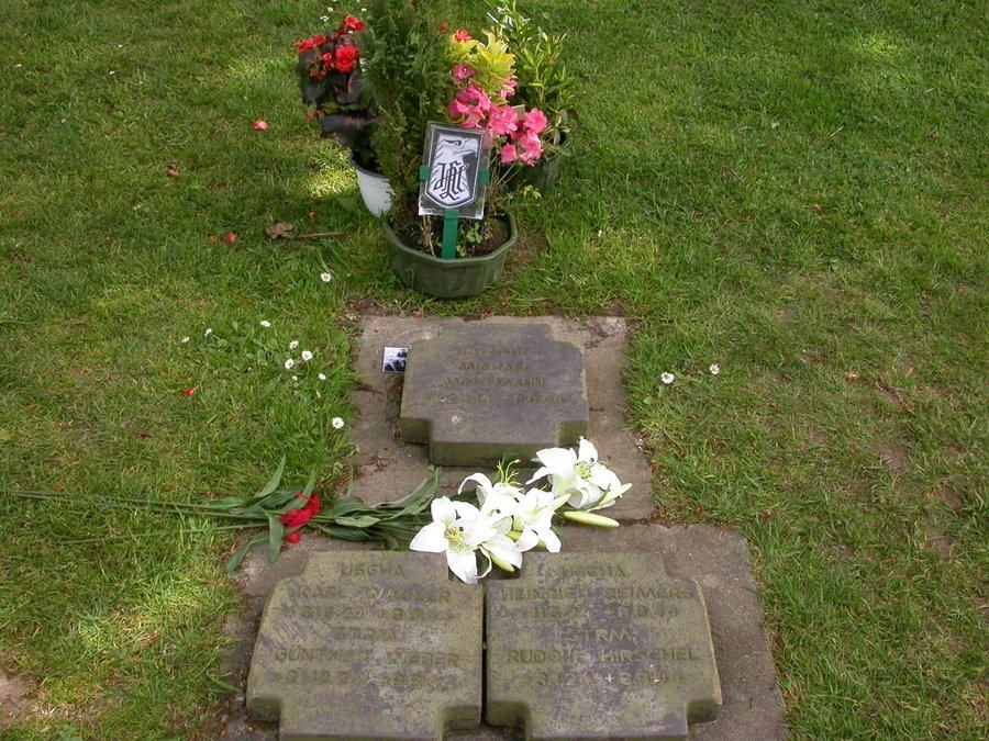 Flowers have been laid on a set of grave marker plaques